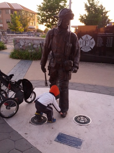 touching the fireman statue's toes